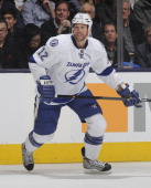 Ryan Malone of the Tampa Bay Lightning skates during NHL game action against the Toronto Maple Leafs January 28 2014 at the Air Canada Centre in...