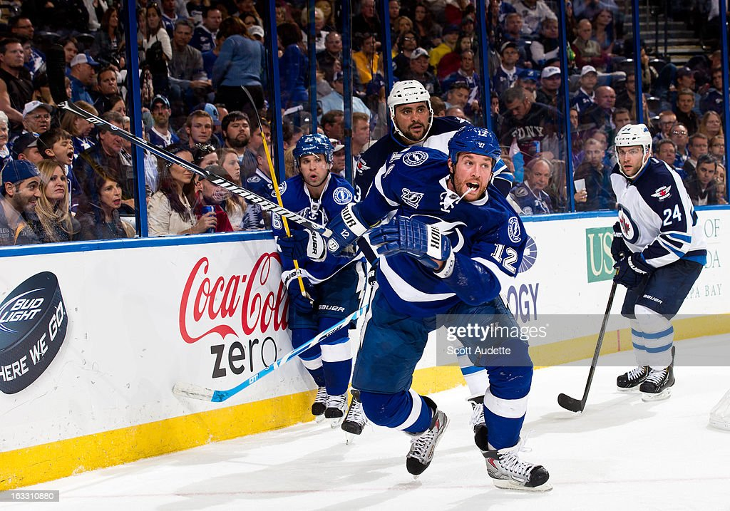 <a gi-track='captionPersonalityLinkClicked' href=/galleries/search?phrase=Ryan+Malone&family=editorial&specificpeople=206964 ng-click='$event.stopPropagation()'>Ryan Malone</a> #12 of the Tampa Bay Lightning skates during the third period of the game against Winnipeg Jets at the Tampa Bay Times Forum on March 7, 2013 in Tampa, Florida.