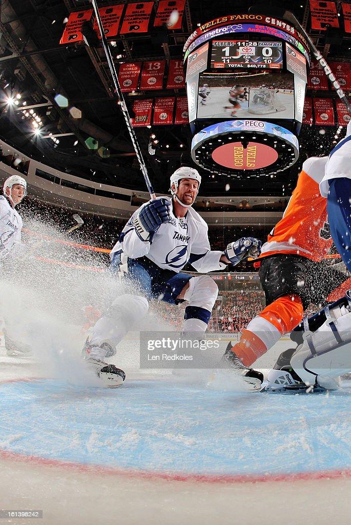 Ryan Malone #12 of the Tampa Bay Lightning skates in the crease against the Philadelphia Flyers on February 5, 2013 at the Wells Fargo Center in Philadelphia, Pennsylvania.