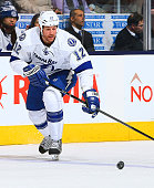 Ryan Malone of the Tampa Bay Lightning skates up the ice against the Toronto Maple Leafs during NHL action at the Air Canada Centre January 28 2014...
