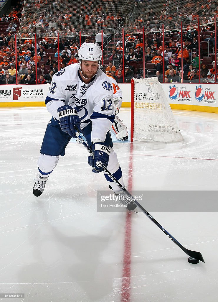 Ryan Malone #12 of the Tampa Bay Lightning skates with the puck against the Philadelphia Flyers on February 5, 2013 at the Wells Fargo Center in Philadelphia, Pennsylvania.