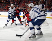 Ryan Malone of the Tampa Bay Lightning skates with the puck against the Florida Panthers at the BBT Center on October 27 2013 in Sunrise Florida