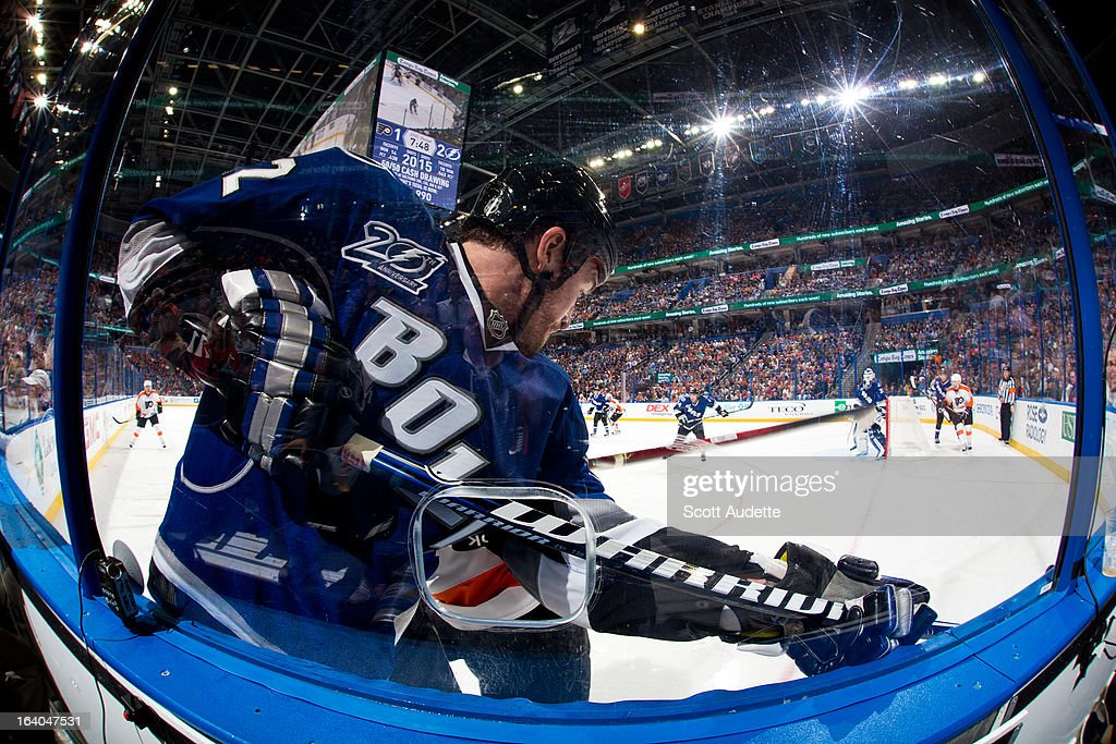 Ryan Malone #12 of the Tampa Bay Lightning slams into the glass during the third period of the game against the Philadelphia Flyers at the Tampa Bay Times Forum on March 18, 2013 in Tampa, Florida.
