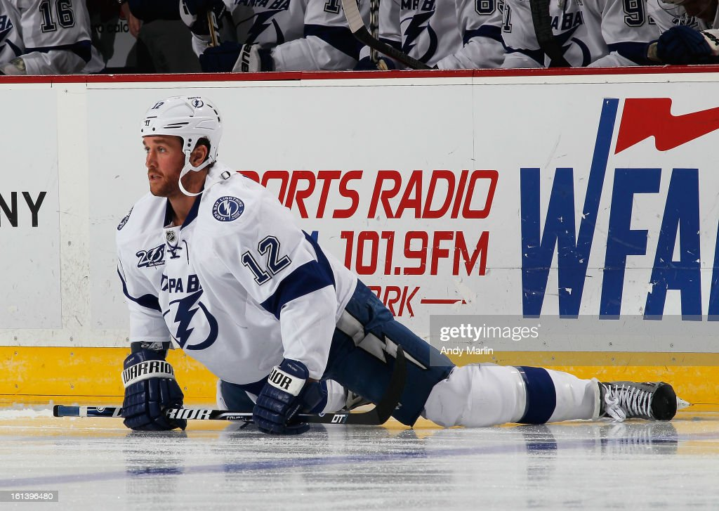 Ryan Malone #12 of the Tampa Bay Lightning stretches during warmups prior to the game against the New Jersey Devils during the game at the Prudential Center on February 7, 2013 in Newark, New Jersey.