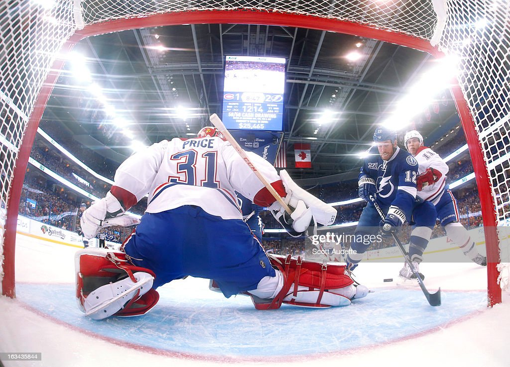 Ryan Malone #12 of the Tampa Bay Lightning unsuccessfully attempts to score while Carey Price #31 of the Montreal Canadiens defends the goal during the second period of the game at the Tampa Bay Times Forum on March 9, 2013 in Tampa, Florida.