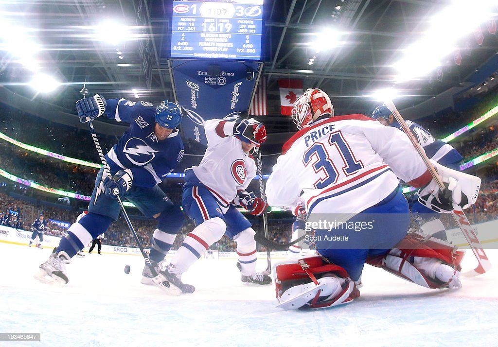<a gi-track='captionPersonalityLinkClicked' href=/galleries/search?phrase=Ryan+Malone&family=editorial&specificpeople=206964 ng-click='$event.stopPropagation()'>Ryan Malone</a> #12 of the Tampa Bay Lightning unsuccessfully attempts to score while <a gi-track='captionPersonalityLinkClicked' href=/galleries/search?phrase=Carey+Price&family=editorial&specificpeople=2222083 ng-click='$event.stopPropagation()'>Carey Price</a> #31 of the Montreal Canadiens defends the goal during the second period of the game at the Tampa Bay Times Forum on March 9, 2013 in Tampa, Florida.