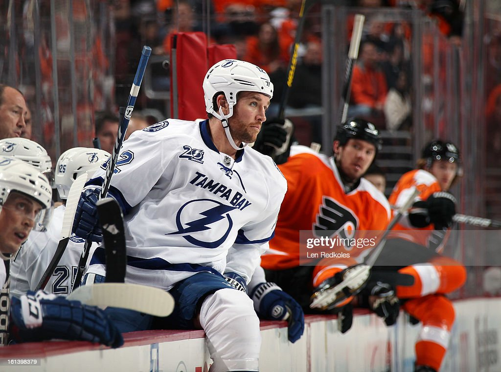 Ryan Malone #12 of the Tampa Bay Lightning watches the play from the bench against the Philadelphia Flyers on February 5, 2013 at the Wells Fargo Center in Philadelphia, Pennsylvania.