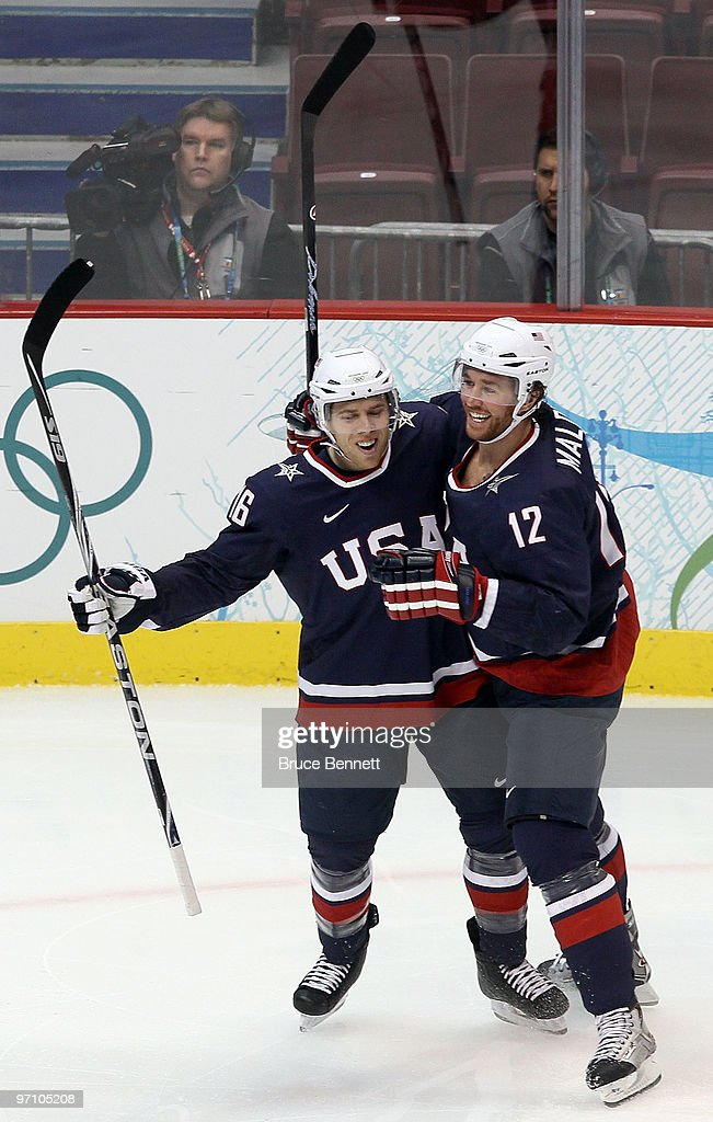 Ryan Malone of the United States celebrates with his team mate Joe Pavelski after Malone scored past goalkeeper Miikka Kiprusoff of Finland during...