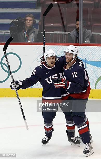 Ryan Malone of the United States celebrates with his team mate Joe Pavelski after Malone scored past goalkeeper Miikka Kiprusoff of Finland during...