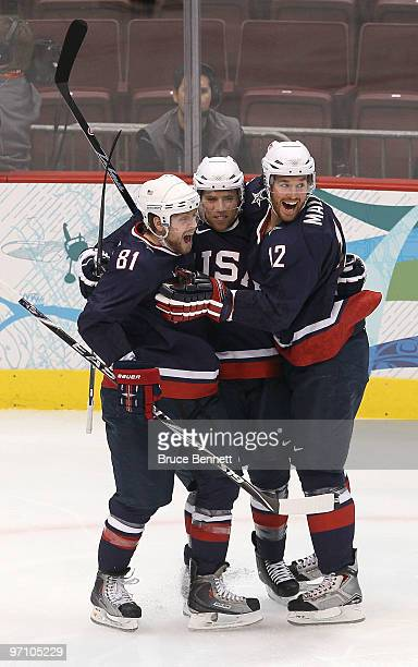 Ryan Malone of the United States celebrates with his team mates after he scored past goalkeeper Miikka Kiprusoff of Finland during the ice hockey...