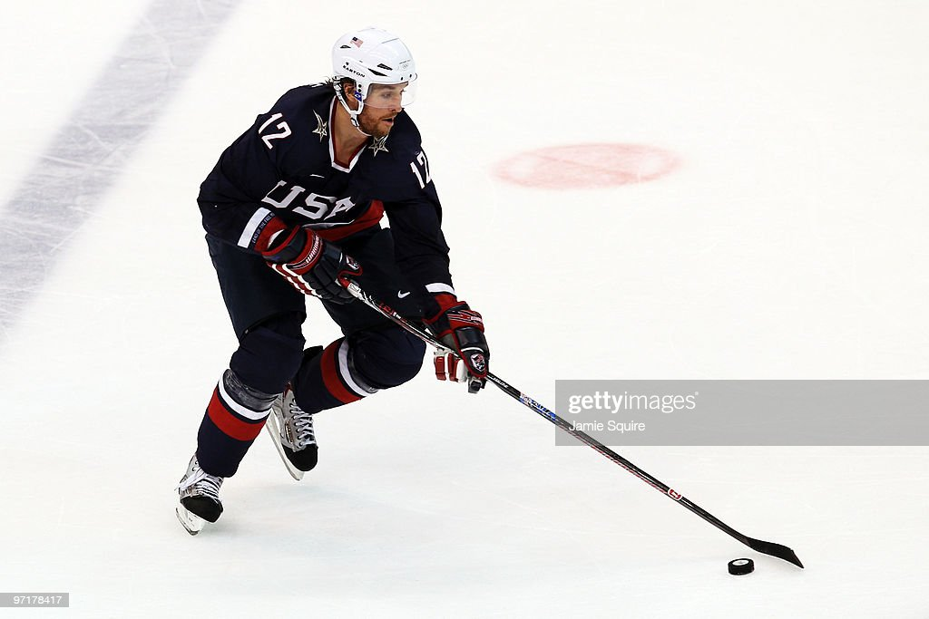 Ryan Malone of the United States skates with the puck during the ice hockey men's gold medal game between USA and Canada on day 17 of the Vancouver...