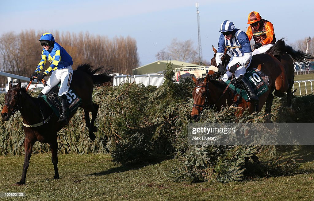 Ryan Mania riding Auroras Encore clears the last fence ahead of Teaforthree ridden by Nick Schofield on their way to victory in the John Smiths Grand National at Aintree Racecourse on April 6, 2013 in Liverpool, England.