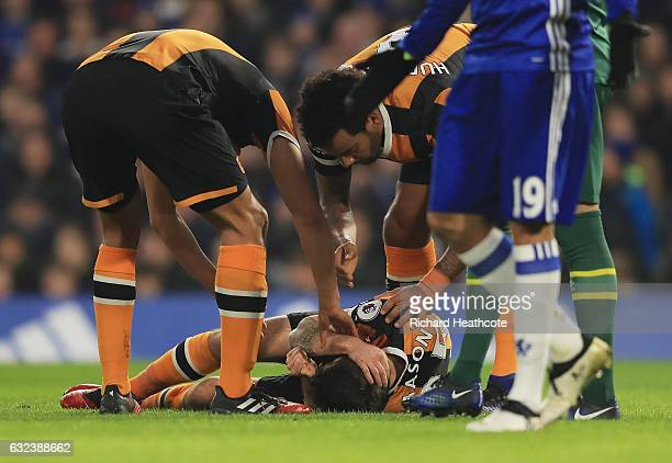 Ryan Mason of Hull City lies injured after the collision with Gary Cahill of Chelsea during the Premier League match between Chelsea and Hull City at...