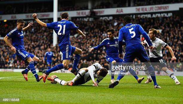 Ryan Mason of Tottenham Hotspur is crowded out by the Chelsea defence during the Barclays Premier League match between Tottenham Hotspur and Chelsea...