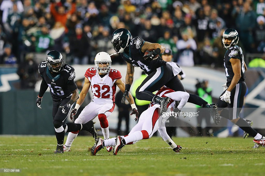 Ryan Mathews of the Philadelphia Eagles is tackled by at Jerraud Powers of the Arizona Cardinals in the second quarter at Lincoln Financial Field on...