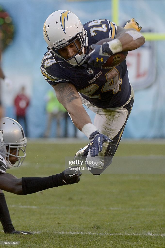 Ryan Mathews #24 of the San Diego Chargers dives with the ball against the Oakland Raiders on December 22, 2013 at Qualcomm Stadium in San Diego, California.