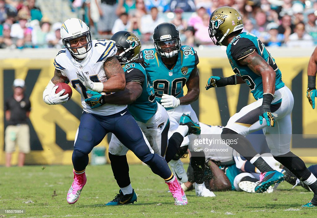 Ryan Mathews #24 of the San Diego Chargers is tackled by Johnathan Cyprien #37 of the Jacksonville Jaguars during the game at EverBank Field on October 20, 2013 in Jacksonville, Florida.
