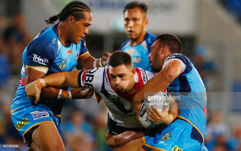 Ryan Matterson of the Roosters is tackled during the round one NRL match between the Gold Coast Titans and the Sydney Roosters at Cbus Super Stadium on March 4, 2017 in Gold Coast, Australia.