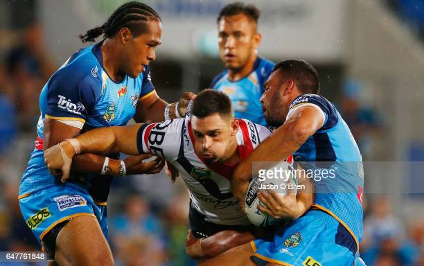 Ryan Matterson of the Roosters is tackled during the round one NRL match between the Gold Coast Titans and the Sydney Roosters at Cbus Super Stadium...