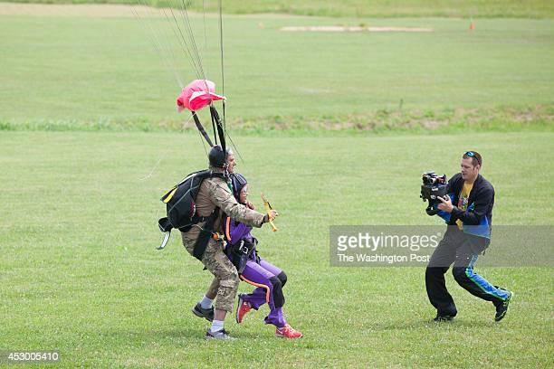 Ryan McDaniel right video records a first time tandem skydiver attached by harness to Mario Ripa at Skydive Orange in Orange Va on June 29 2014