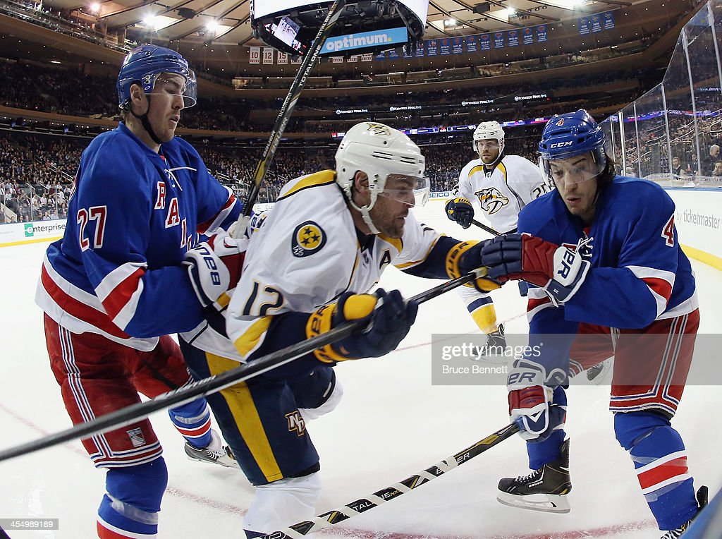 <a gi-track='captionPersonalityLinkClicked' href=/galleries/search?phrase=Ryan+McDonagh&family=editorial&specificpeople=4324983 ng-click='$event.stopPropagation()'>Ryan McDonagh</a> #27 and <a gi-track='captionPersonalityLinkClicked' href=/galleries/search?phrase=Michael+Del+Zotto&family=editorial&specificpeople=4044191 ng-click='$event.stopPropagation()'>Michael Del Zotto</a> #4 of the New York Rangers combine to stop <a gi-track='captionPersonalityLinkClicked' href=/galleries/search?phrase=Mike+Fisher+-+Ice+Hockey+Player&family=editorial&specificpeople=204732 ng-click='$event.stopPropagation()'>Mike Fisher</a> #12 of the Nashville Predators at Madison Square Garden on December 10, 2013 in New York City. The Predators defeated the Rangers 4-1.