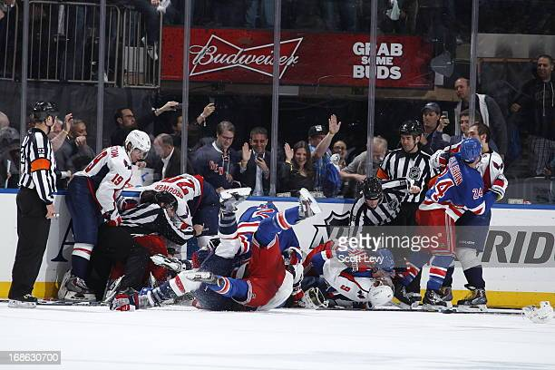 Ryan McDonagh and Ryan Callahan of the New York Rangers fight with Mike Ribeiro and Alex Ovechkin of the Washington Capitals in Game Six of the...