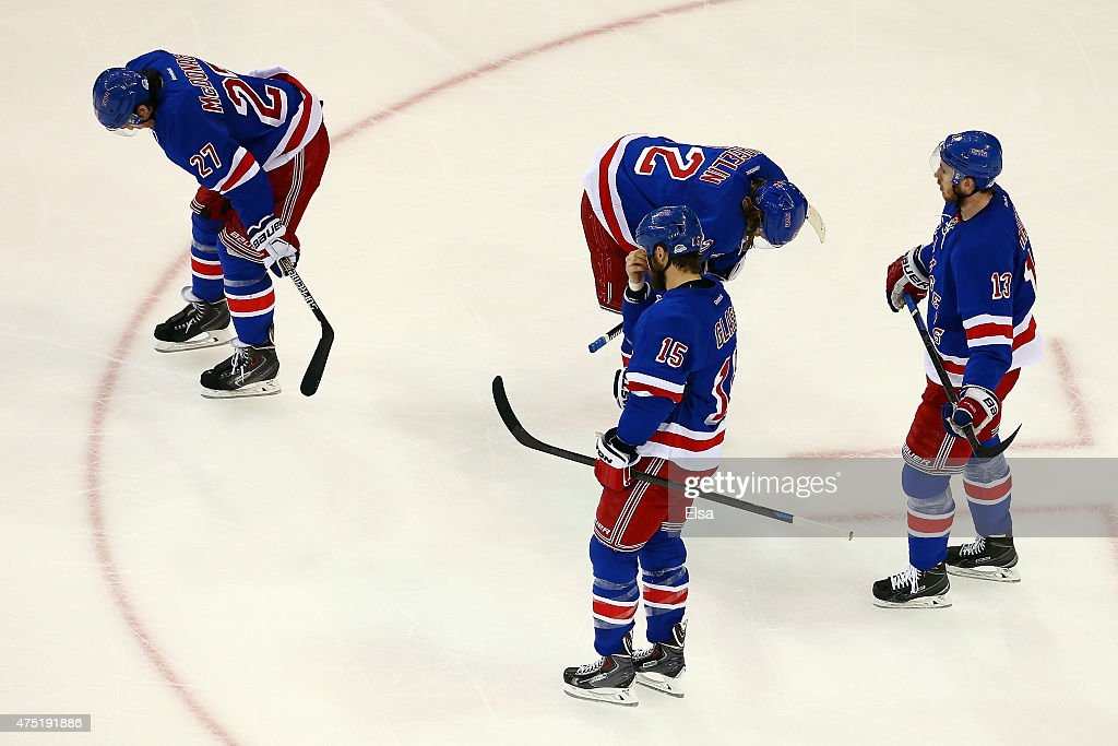 <a gi-track='captionPersonalityLinkClicked' href=/galleries/search?phrase=Ryan+McDonagh&family=editorial&specificpeople=4324983 ng-click='$event.stopPropagation()'>Ryan McDonagh</a> #27, <a gi-track='captionPersonalityLinkClicked' href=/galleries/search?phrase=Carl+Hagelin&family=editorial&specificpeople=4465394 ng-click='$event.stopPropagation()'>Carl Hagelin</a> #62, <a gi-track='captionPersonalityLinkClicked' href=/galleries/search?phrase=Tanner+Glass&family=editorial&specificpeople=4596666 ng-click='$event.stopPropagation()'>Tanner Glass</a> #15 and <a gi-track='captionPersonalityLinkClicked' href=/galleries/search?phrase=Kevin+Hayes+-+Ice+Hockey+Player&family=editorial&specificpeople=13635523 ng-click='$event.stopPropagation()'>Kevin Hayes</a> #13 of the New York Rangers react after being defeated by the Tampa Bay Lightning 2 to 0 in Game Seven of the Eastern Conference Finals during the 2015 NHL Stanley Cup Playoffs at Madison Square Garden on May 29, 2015 in New York City.