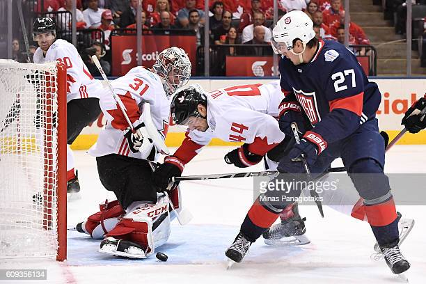 Ryan McDonagh of Team USA collides with MarcEdouard Vlasic in front of Carey Price of Team Canada during the World Cup of Hockey 2016 at Air Canada...