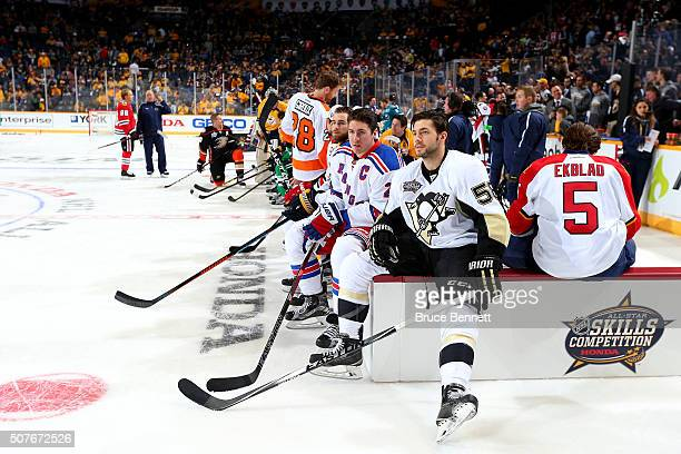 Ryan McDonagh of the New York Rangers and Kris Letang of the Pittsburgh Penguins look on in the DraftKings NHL Accuracy Shooting during the 2016...