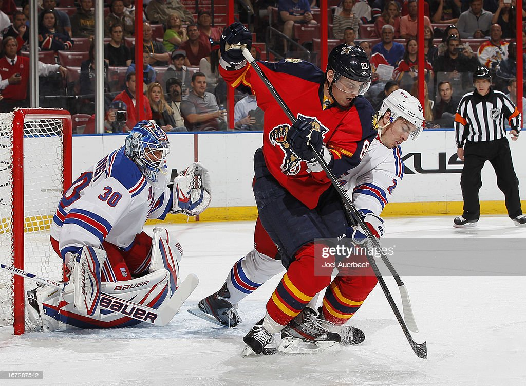 Ryan McDonagh #27 of the New York Rangers and Tomas Kopecky #82 of the Florida Panthers battle for position in front of the net at the BB&T Center on April 23, 2013 in Sunrise, Florida.