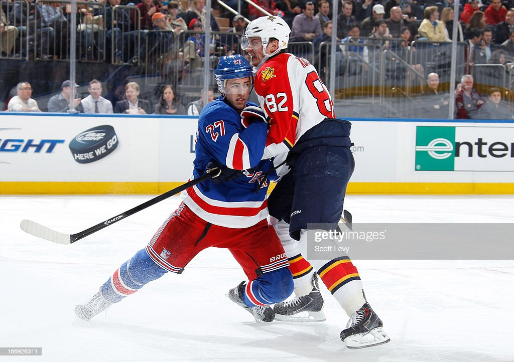 Ryan McDonagh #27 of the New York Rangers battles with Tomas Kopecky #82 of the Florida Panthers at Madison Square Garden on April 18, 2013 in New York City.
