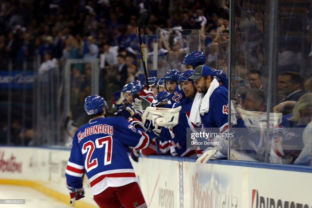 <a gi-track='captionPersonalityLinkClicked' href=/galleries/search?phrase=Ryan+McDonagh&family=editorial&specificpeople=4324983 ng-click='$event.stopPropagation()'>Ryan McDonagh</a> #27 of the New York Rangers celebrates with his teammates on the bench after Taylor Pyatt #14 scored a goal in the second period against Tuukka Rask #40 of the Boston Bruins in Game Three of the Eastern Conference Semifinals during the 2013 NHL Stanley Cup Playoffs at Madison Square Garden on May 21, 2013 in New York City.