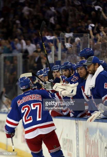 Ryan McDonagh of the New York Rangers celenbrates with his teammates on the bench after Taylor Pyatt of the New York Rangers scored a goal in the...