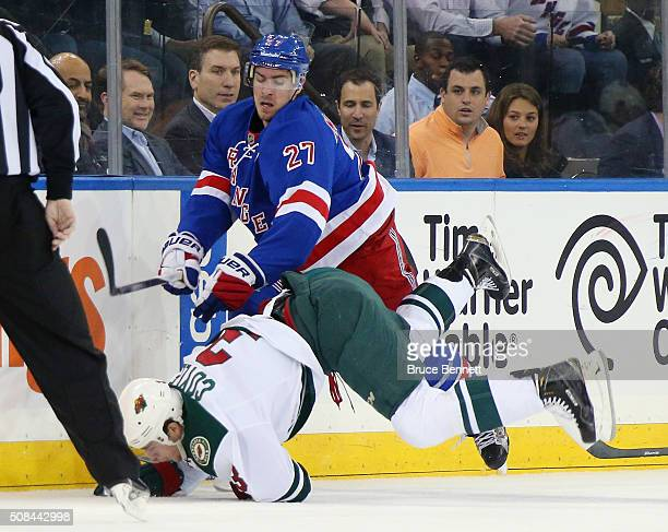 Ryan McDonagh of the New York Rangers checks Charlie Coyle of the Minnesota Wild during the first period at Madison Square Garden on February 4 2016...