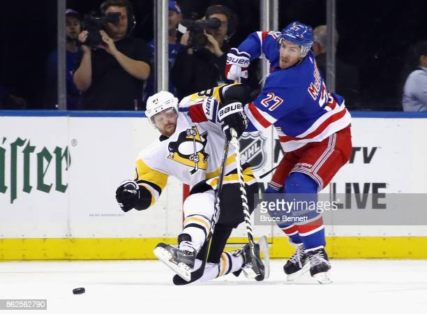 Ryan McDonagh of the New York Rangers checks Phil Kessel of the Pittsburgh Penguins during the second period at Madison Square Garden on October 17...