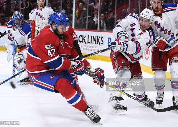 Ryan McDonagh of the New York Rangers clears the puck against Alexander Radulov of the Montreal Canadiens in Game Two of the Eastern Conference...