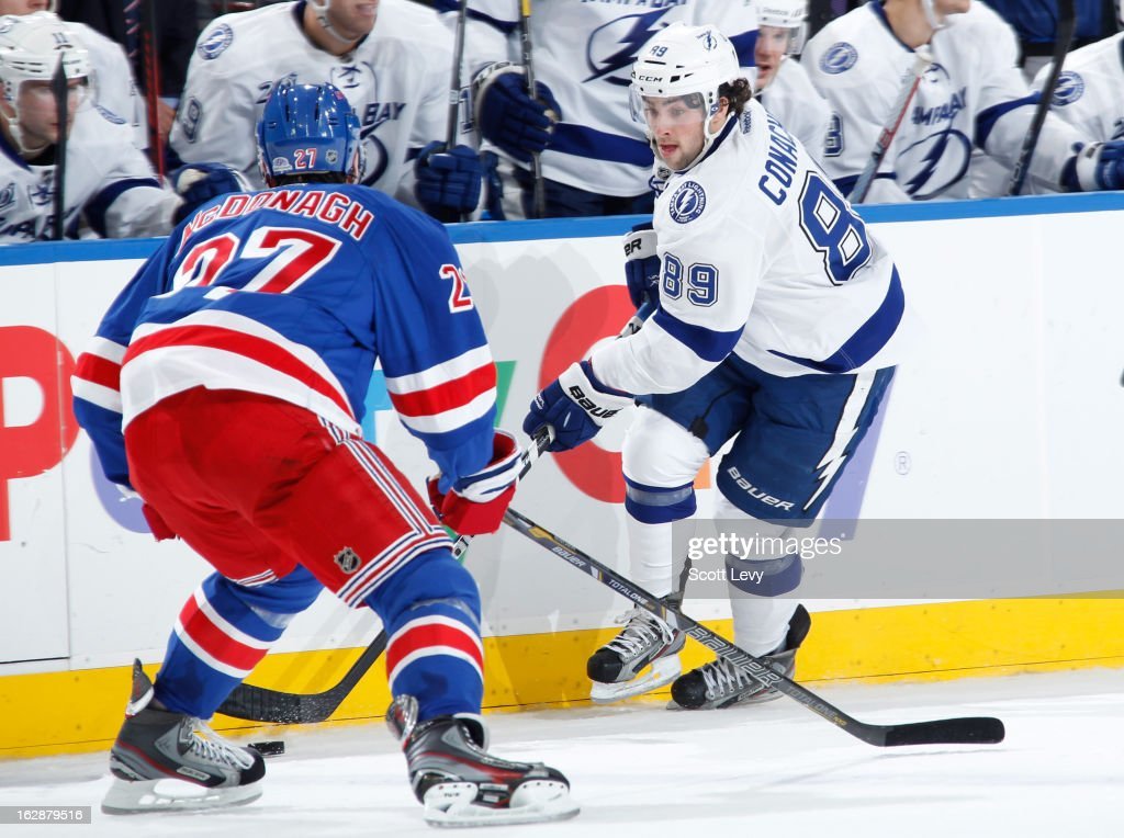 <a gi-track='captionPersonalityLinkClicked' href=/galleries/search?phrase=Ryan+McDonagh&family=editorial&specificpeople=4324983 ng-click='$event.stopPropagation()'>Ryan McDonagh</a> #27 of the New York Rangers defends against Cory Conacher #89 of the Tampa Bay Lightning at Madison Square Garden on February 28, 2013 in New York City.