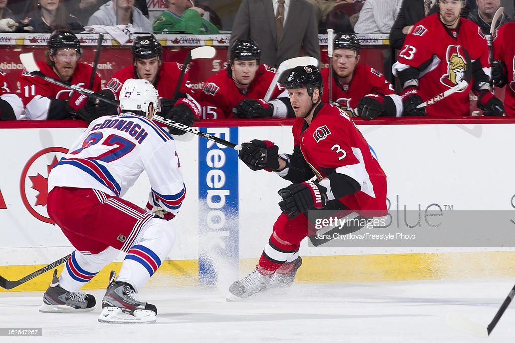 Ryan McDonagh #27 of the New York Rangers defends against Marc Methot #3 of the Ottawa Senators during an NHL game at Scotiabank Place on February 21, 2013 in Ottawa, Ontario, Canada.