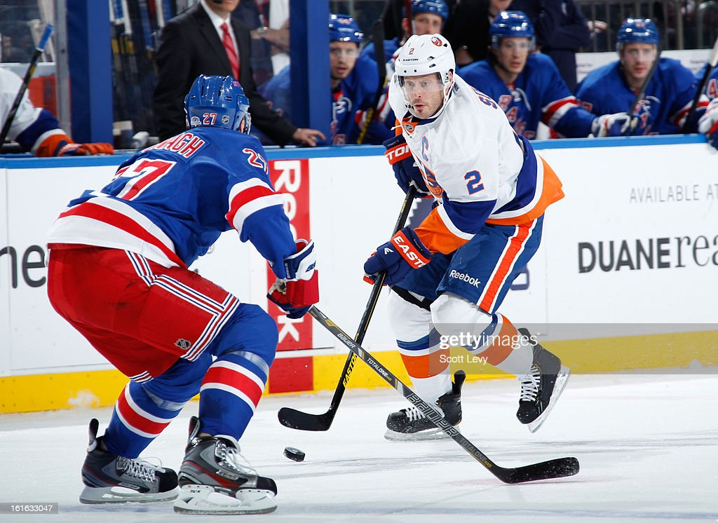 <a gi-track='captionPersonalityLinkClicked' href=/galleries/search?phrase=Ryan+McDonagh&family=editorial&specificpeople=4324983 ng-click='$event.stopPropagation()'>Ryan McDonagh</a> #27 of the New York Rangers defends against <a gi-track='captionPersonalityLinkClicked' href=/galleries/search?phrase=Mark+Streit&family=editorial&specificpeople=636976 ng-click='$event.stopPropagation()'>Mark Streit</a> #2 of the New York Islanders at Madison Square Garden on February 7, 2013 in New York City.