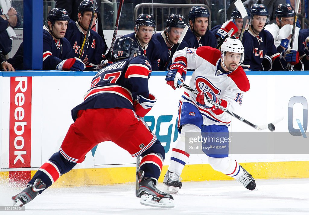 <a gi-track='captionPersonalityLinkClicked' href=/galleries/search?phrase=Ryan+McDonagh&family=editorial&specificpeople=4324983 ng-click='$event.stopPropagation()'>Ryan McDonagh</a> #27 of the New York Rangers defends against <a gi-track='captionPersonalityLinkClicked' href=/galleries/search?phrase=Tomas+Plekanec&family=editorial&specificpeople=620244 ng-click='$event.stopPropagation()'>Tomas Plekanec</a> #14 of the Montreal Canadiens at Madison Square Garden on February 19, 2013 in New York City.