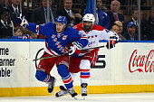 Ryan McDonagh of the New York Rangers fights for position against Joel Ward of the Washington Capitals in Game Seven of the Eastern Conference...