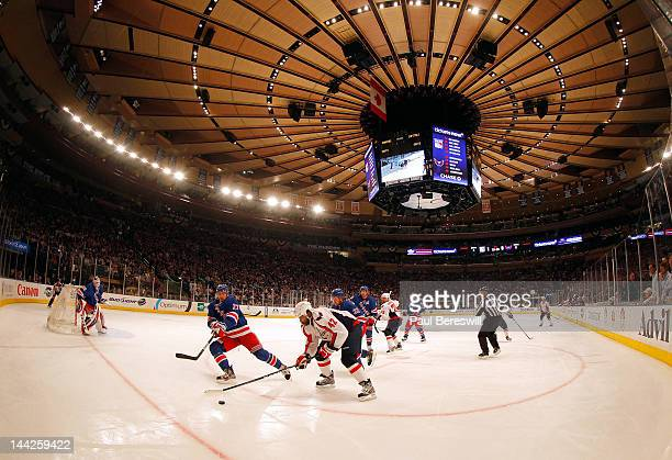 Ryan McDonagh of the New York Rangers fights for the puck in the first period against Joel Ward of the Washington Capitals in Game Seven of the...