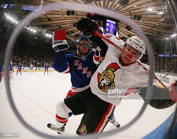Ryan McDonagh of the New York Rangers hits Colin Greening of the Ottawa Senators into the boards in Game Two of the Eastern Conference Quarterfinals...
