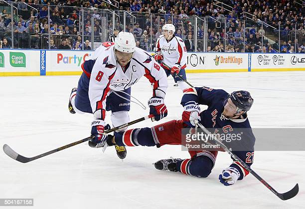 Ryan McDonagh of the New York Rangers is checked by Alex Ovechkin of the Washington Capitals during the second period at Madison Square Garden on...