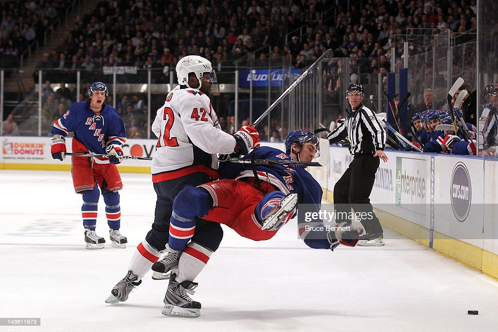 <a gi-track='captionPersonalityLinkClicked' href=/galleries/search?phrase=Ryan+McDonagh&family=editorial&specificpeople=4324983 ng-click='$event.stopPropagation()'>Ryan McDonagh</a> #27 of the New York Rangers is checked to the ice in the second period by Joel Ward #42 of the Washington Capitals in Game Two of the Eastern Conference Semifinals during the 2012 NHL Stanley Cup Playoffs at Madison Square Garden on April 30, 2012 in New York City.