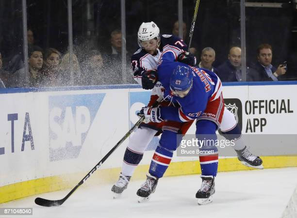 Ryan McDonagh of the New York Rangers is hit by Josh Anderson of the Columbus Blue Jackets during the first period at Madison Square Garden on...