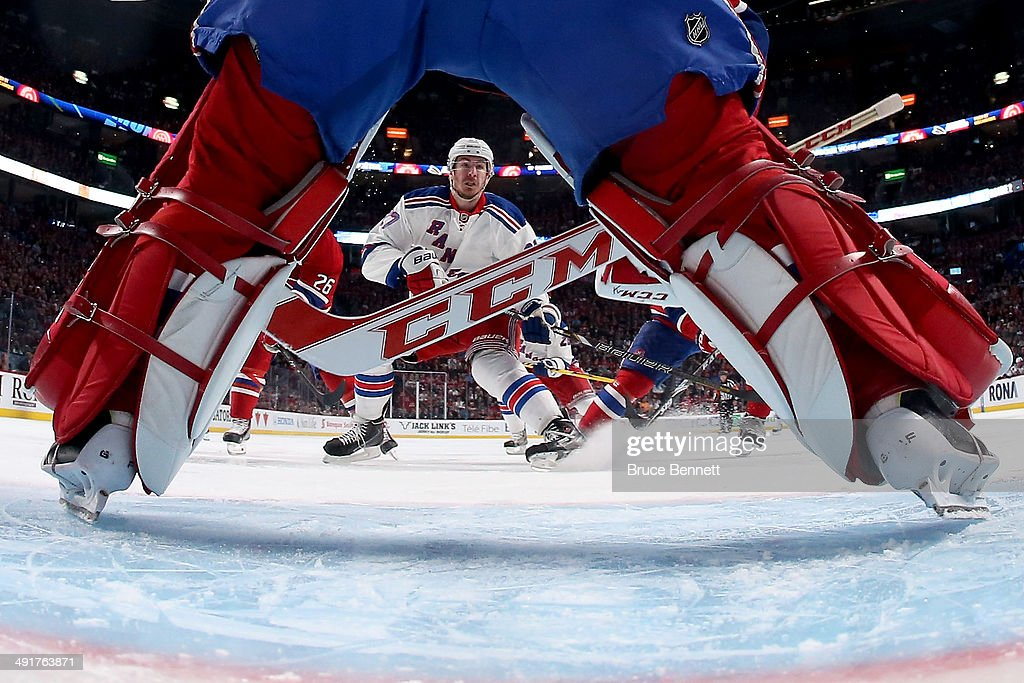 Ryan McDonagh #27 of the New York Rangers is seen in the legs of goaltender Carey Price #31 of the Montreal Canadiens in the first period in Game One of the Eastern Conference Finals of the 2014 NHL Stanley Cup Playoffs at the Bell Centre on May 17, 2014 in Montreal, Canada.