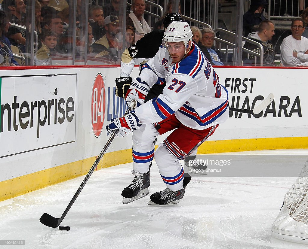 <a gi-track='captionPersonalityLinkClicked' href=/galleries/search?phrase=Ryan+McDonagh&family=editorial&specificpeople=4324983 ng-click='$event.stopPropagation()'>Ryan McDonagh</a> #27 of the New York Rangers moves the puck against the Pittsburgh Penguins in Game Five of the Second Round of the 2014 Stanley Cup Playoffs at Consol Energy Center on May 9, 2014 in Pittsburgh, Pennsylvania.