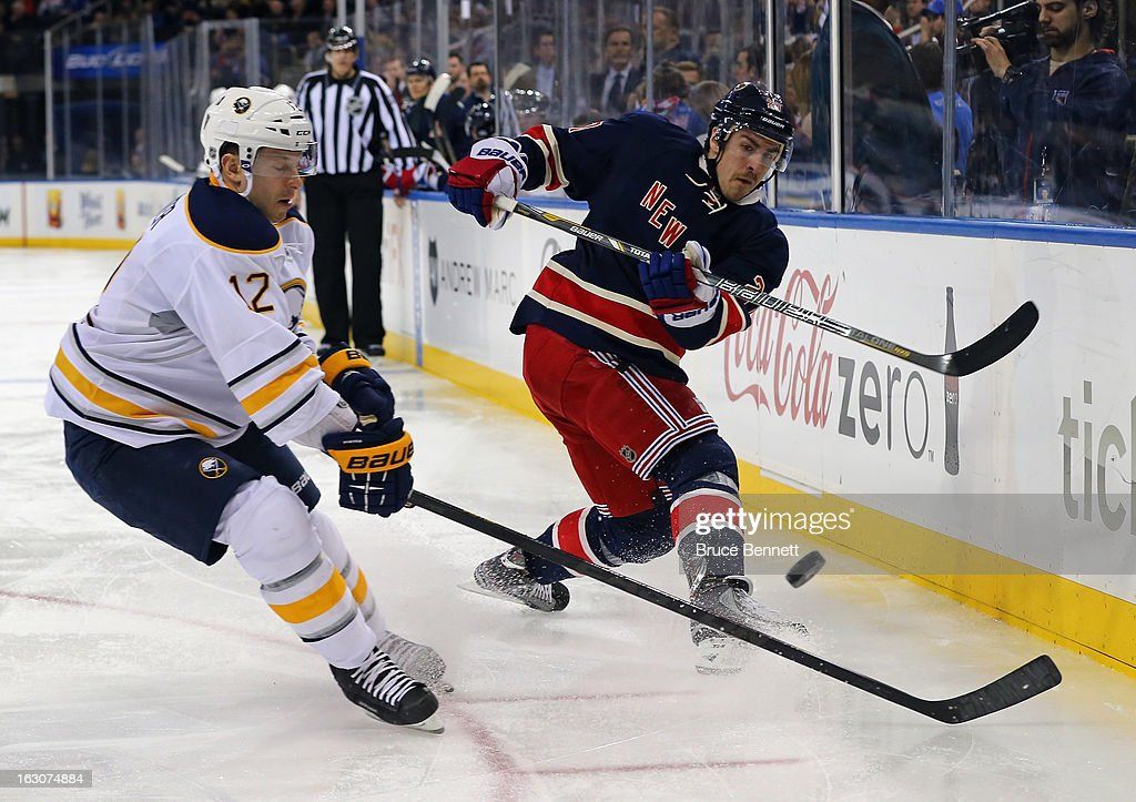 Ryan McDonagh #27 of the New York Rangers shoots the puck against the Buffalo Sabres at Madison Square Garden on March 3, 2013 in New York City.