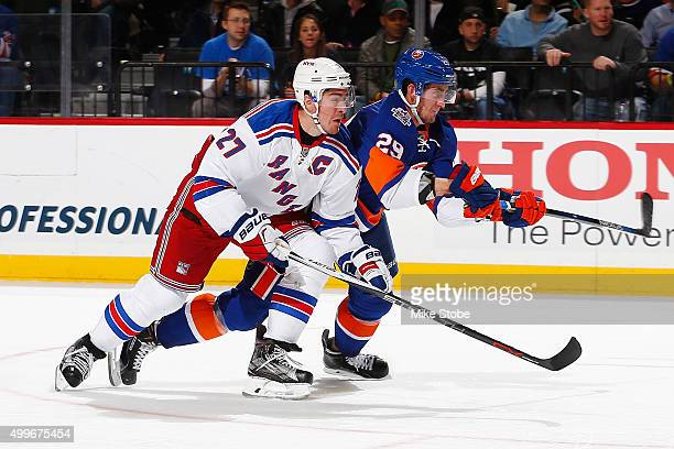 Ryan McDonagh of the New York Rangers skates against Brock Nelson of the New York Islanders during the game at the Barclays Center on December 2 2015...